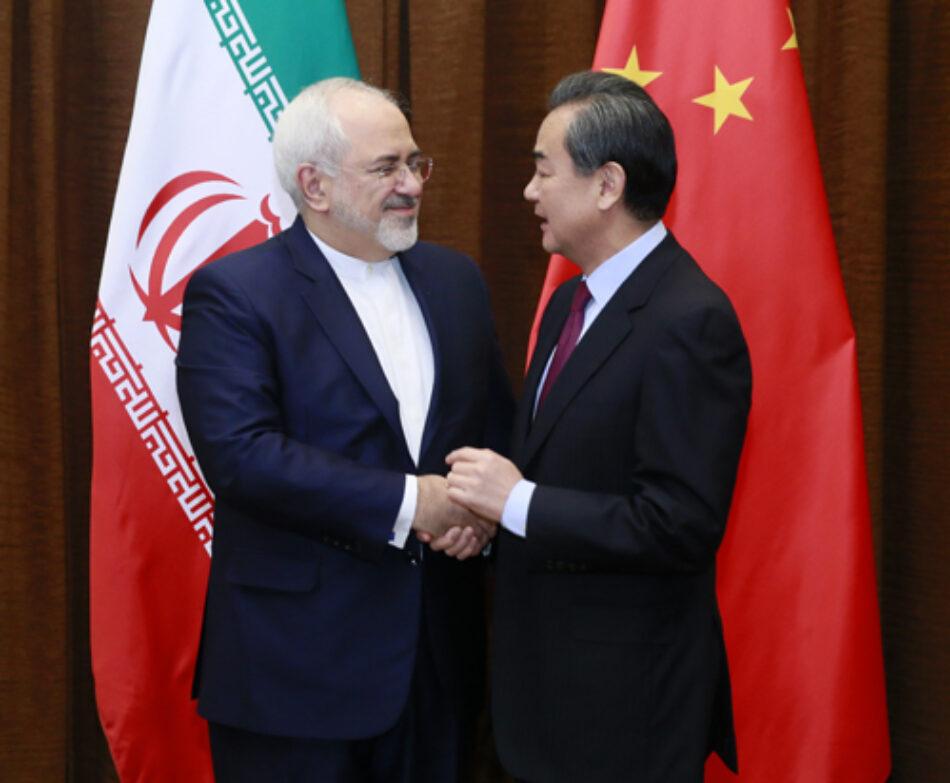 Cancilleres de China e Irán discuten crisis globales